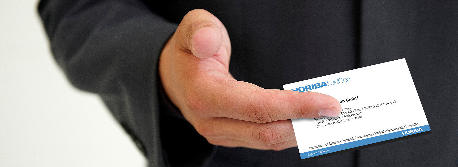 Close-up of a Hand holding a HORIBA FuelCon Business Card