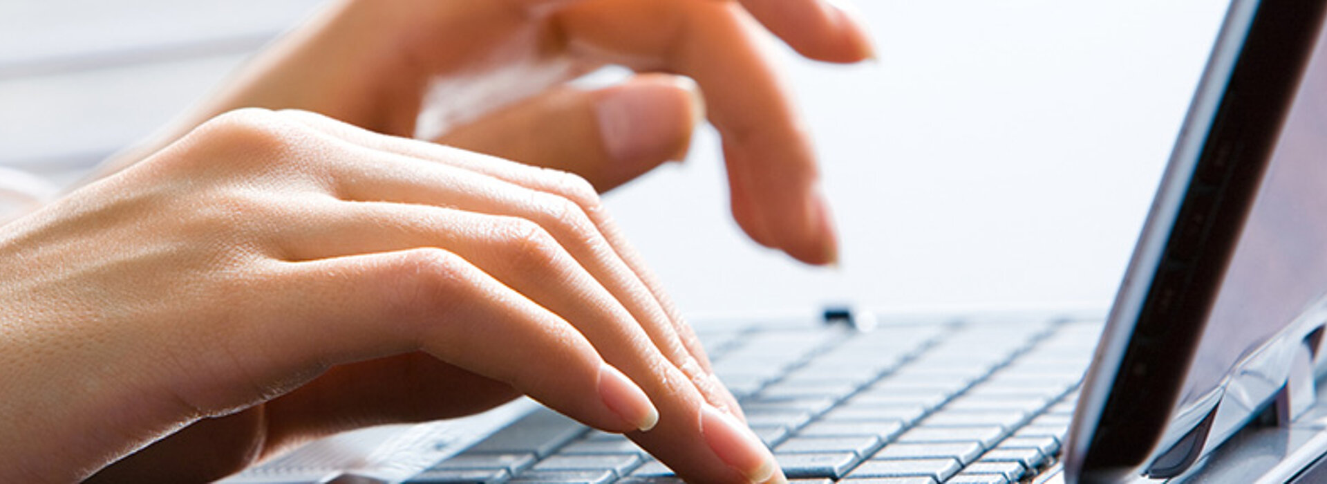 Close-up of Hands typing on a Laptop Keyboard